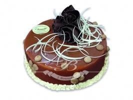 Tort ciasteczkowy - Chrupiąca ciasteczkowa niespodzianka w połączeniu z czekoladowo-karmelowym musem<br> na serku mascarpone w ciemnym biszkopcie z wiśniami.